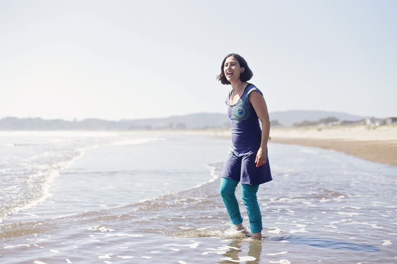 Me/Andrea in the water at Stinson Beach, photo by John Nieto